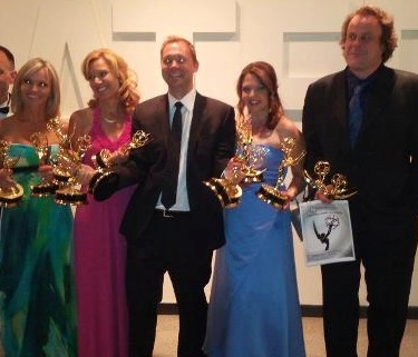 WBFF Fox45-TV reporters and producers (left to right): Jennifer Gilbert, Kathleen Cairns, David Larson, Melinda Roeder and Stephen Janis — shown here after winning Emmys for their exemplary work in 2012 — have been nominated once again in 2014, along with the station's chief anchorman Jeff Barnd and photographer Joseph O'Neil, multimedia analyst Paul Gessler, Janice Park, and reporter Joy Lepola (not shown).