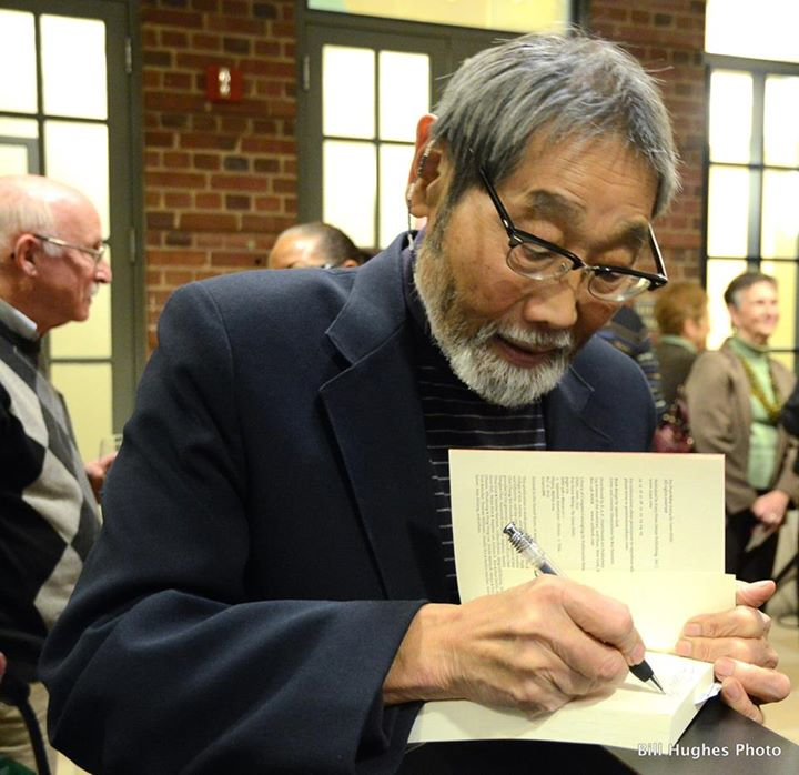 Gene Oishi autographs his new novel, Fox Drum Bebop, at Mount Washington Conference Center.  (VoB Photos/Bill Hughes)
