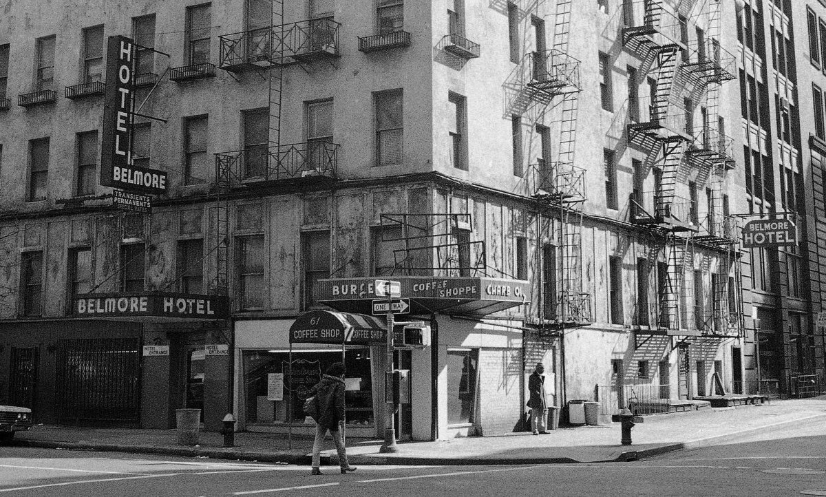 """A nondescript structure on Lexington Avenue and 23rd Street, it had a sign attached to the Lex. Avenue side"" which read ""HOTEL"" in capital letters top-to-bottom."