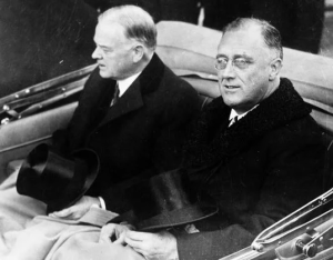 Herbert Hoover, left, rides with Franklin Delano Roosevelt to Roosevelt's inauguration as America's 32nd President (March 4, 1933).  FDR defeated Hoover by a landslide after the 31st President failed to deal effectively with the Great Depression.
